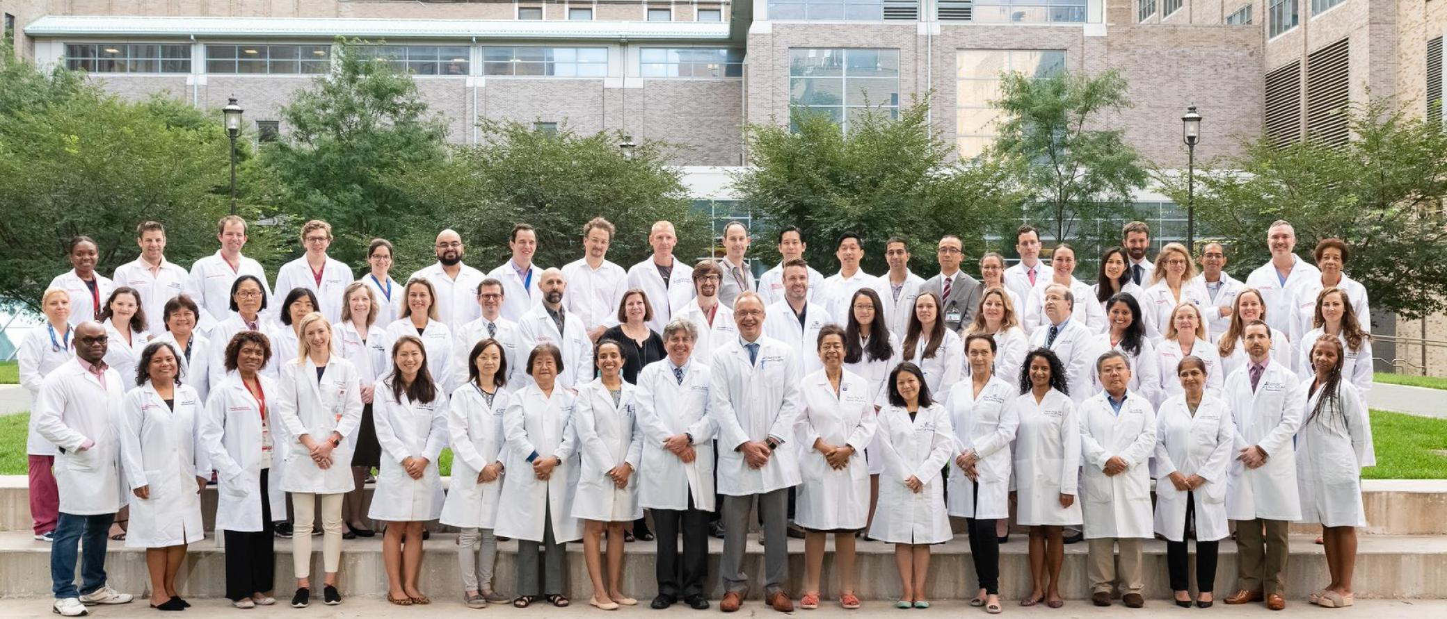 Clinical members of the department of Anesthesiology dressed in white coats.